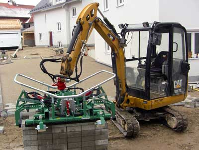 Small excavator as carrier machine